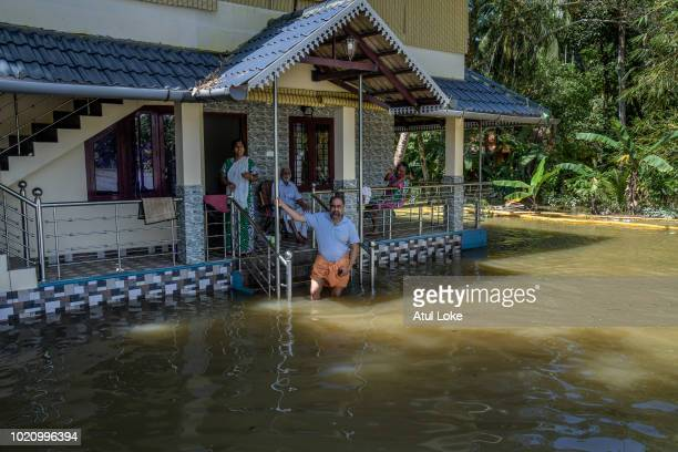 Local residents at their homes during a flood on August 21 2018 in Kerala India Over 400 people have reportedly died in the southern Indian state of...