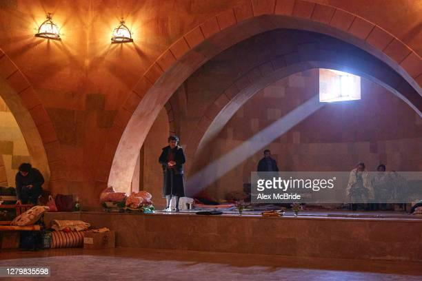 Local residents attend a church service in the basement of an undisclosed church on October 12, 2020 in Stepanakert, Nagorno-Karabakh. On the day...