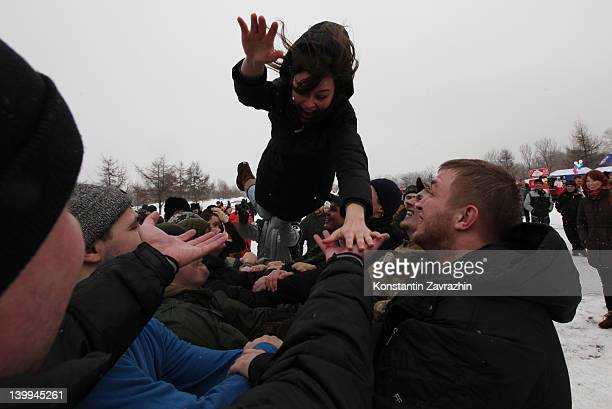 Local residents attend a jumping game during the celebrations of Maslenitsa or Pancake week on February 2012 in Moscow Russia Dating back to pagan...