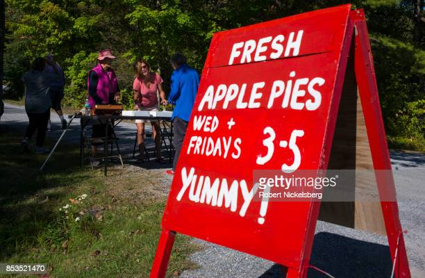 Local residents buy freshly baked apple pies for a benefit sale at the Congregational Church in Charlotte Vermont September 22 2017