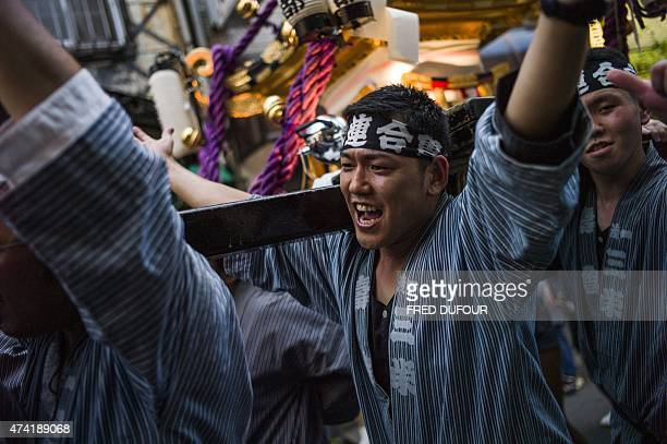 Local residents carry a portable shrine or 'mikoshi' in Asakusa district during Tokyo's largest festival called 'Sanja Matsuri' in Tokyo on May 15...