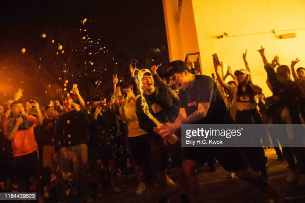 Local residents celebrate as Junius Ho Kwanyiu lose in District Council Elections outside a polling station on November 25 2019 in Hong Kong China...