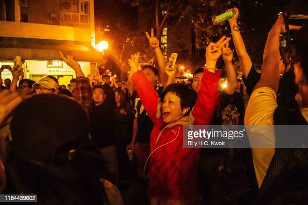Local residents celebrate as Junius Ho Kwanyiu loses in District Council Elections outside a polling station on November 25 2019 in Hong Kong China...