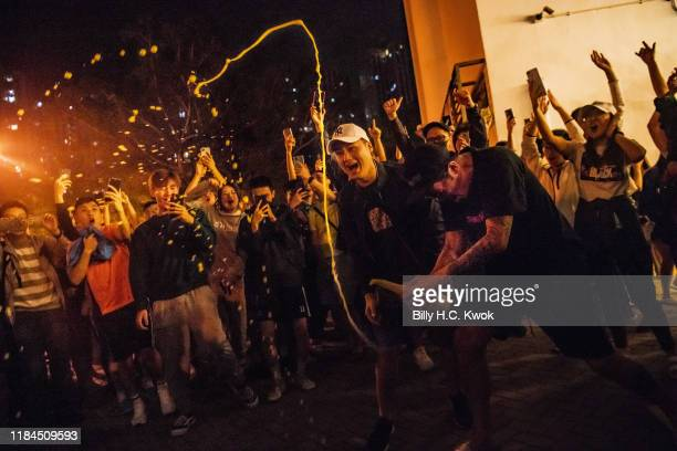 Local residents celebrate outside a polling station as Junius Ho Kwanyiu loses in District Council Elections on November 25 2019 in Hong Kong China...