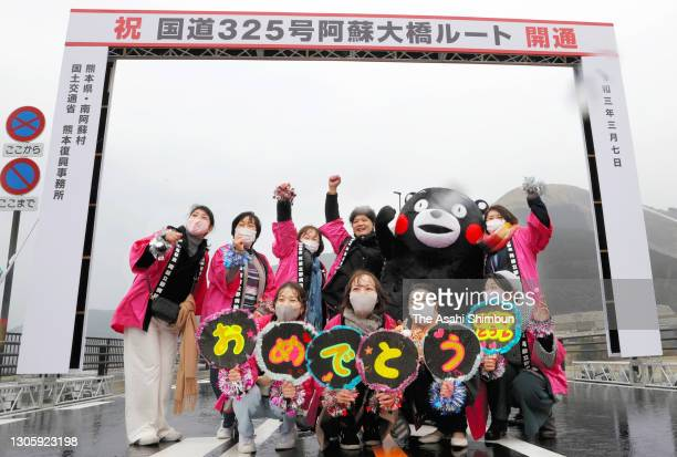 Local residents celebrate the opening of new Aso Ohashi Bridge is seen on March 7, 2021 in Minamiaso, Kumamoto, Japan. The bridge had collapsed in...