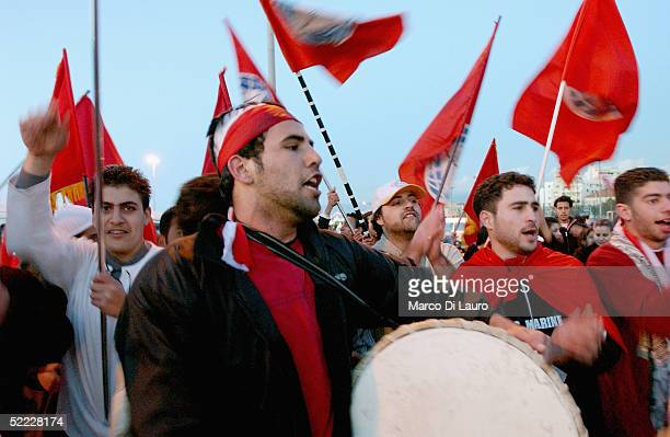 Local residents chant and play drums during a protest over the assasination of Rafik Hariri, the former Lebanese Prime Minister outside the cemetary...