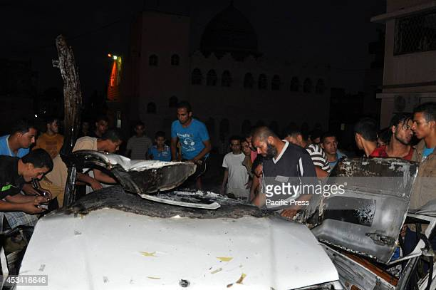 Local residents checking the wreckage of a car, which was hit during Israeli air strike in Rafah in the southern Gaza Strip. Israel launched more...