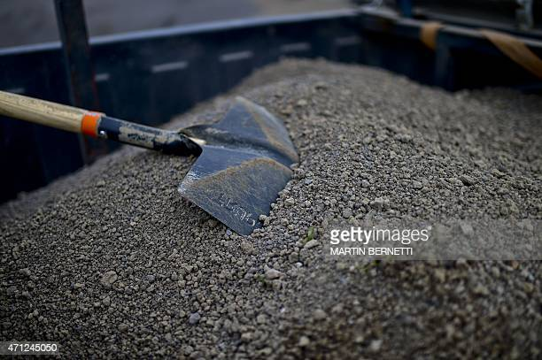 Local residents clean their homes fromf ash from the Calbuco Volcano in La Ensenada, southern Chile, on April 26, 2015. A sleeping giant for more...