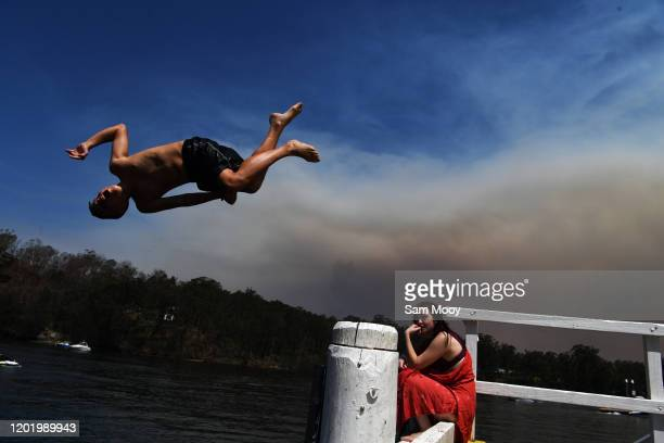 Local residents cool off in the fire affected Clyde River near Batemans Bay on January 26, 2020 in Nellingen, Australia. Australia Day, formerly...