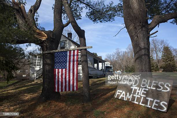 Local residents display signs of support for families of the deceased near the Sandy Hook Elementary School December 15 2012 in Sandy Hook...