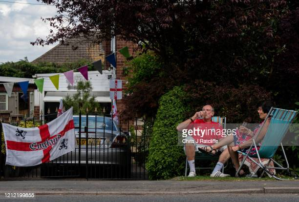 Local residents drink alcohol as they sit outside their homes during a socially distanced street party for VE Day on May 8 2020 in Bulkington United...