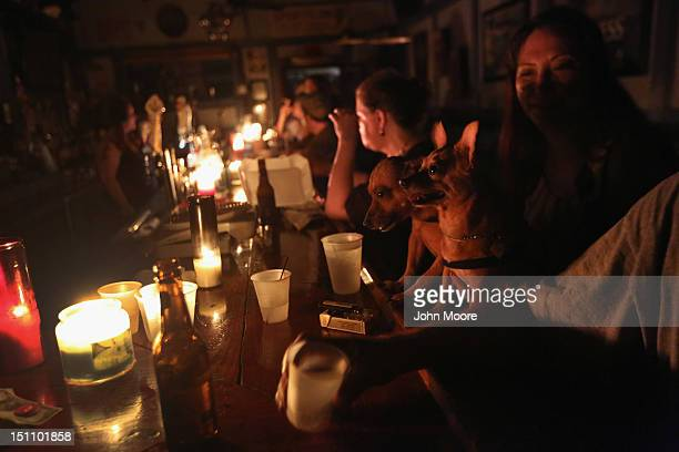 John wicks stock photos and pictures getty images local residents drink by candle light at jjs bar during the continued blackout on august 31 mozeypictures Image collections