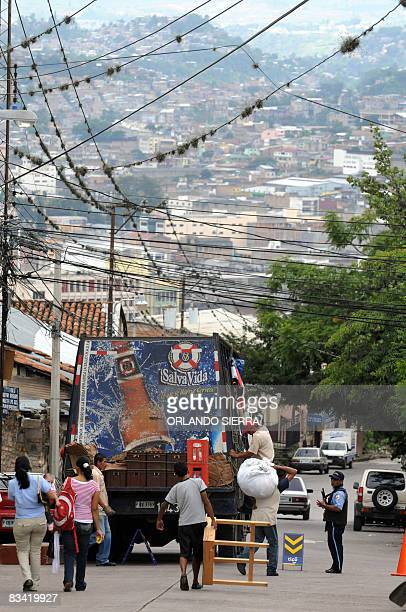 Local residents evacuate their homes on October 24 2008 at El Eden neighborhood on the side of El Picacho hill in Tegucigalpa Some 1000 inhabitants...