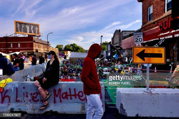Local residents gather at George Floyd Square cleared on June 3 as the city of Minneapolis orders the square cleared for traffic. - Minneapolis...