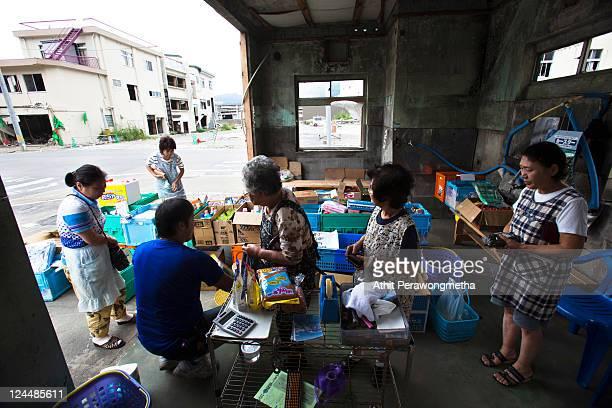 Local residents gather at minimart prior to the sixth month anniversary of the March 11 earthquake and massive tsunami on September 10 2011 in...