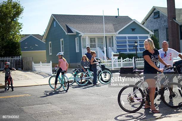 Local residents gather near the site of the 'pipe bombstyle device' explosion which they heard only four houses away on September 17 2016 in Seaside...