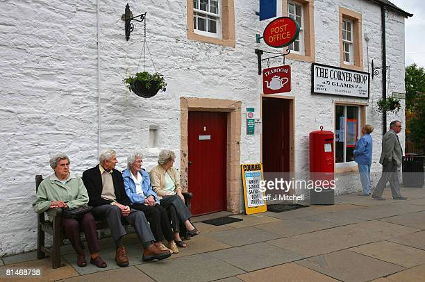 Local residents gather outside Glamis Post Office June 6 2008 in Glamis near Dundee Scotland The Post Office was earmarked closure last week forcing...