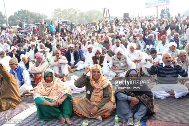Local residents gathered at Toll Plaza in protest against new farm laws, at Makdoli village on Rohtak-Panipat Highway, on December 26, 2020 in...