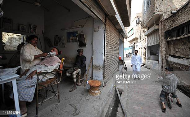 Local residents go about their daily lives in the old town section of Multan on March 17 2012 Multan one of the oldest cities in the Asian...