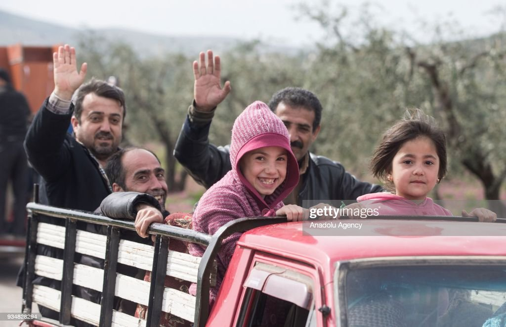Turkey free syrian army take complete control of afrin pictures local residents greet turkish soldiers in town center after turkish armed forces and free syrian army m4hsunfo