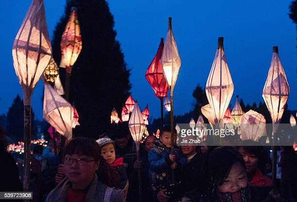 Local residents hold a lantern parade to celebrate the Toad Festival a tradition to wish for good health and harvest in the lunar new year when...