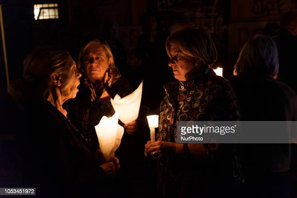 Local residents hold candles outside the entrance of a sequestered derelict building in the San Lorenzo neighbourhood of Rome Italy on October 25 a...