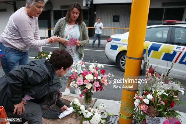 Local residents leave floral tributes at Deans Avenue near the Al Noor Mosque on March 16 2019 in Christchurch New Zealand At least 49 people are...