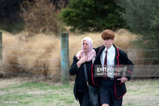 Local residents leave the Memorial Park cemetery following funerals for victims of New Zealand's twin mosque attacks at Memorial Park cemetery in...
