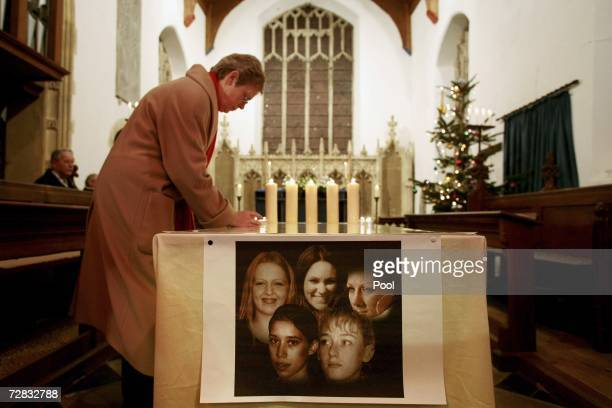 Local residents light candles above a picture of the murdered prostitutes during a service in Copdock church on December 15 2006 in Ipswich England...