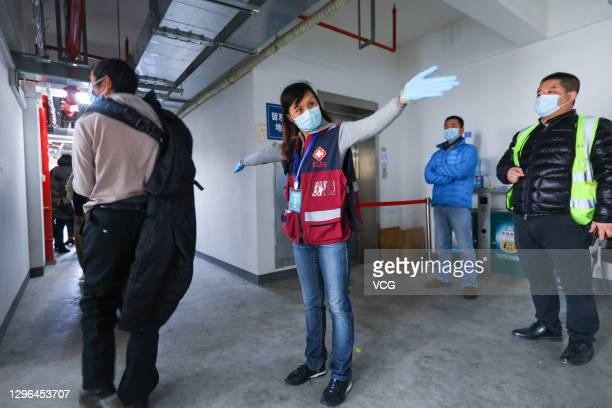 Local residents line up to receive the COVID-19 vaccine at a clinic on January 14, 2021 in Shanghai, China.