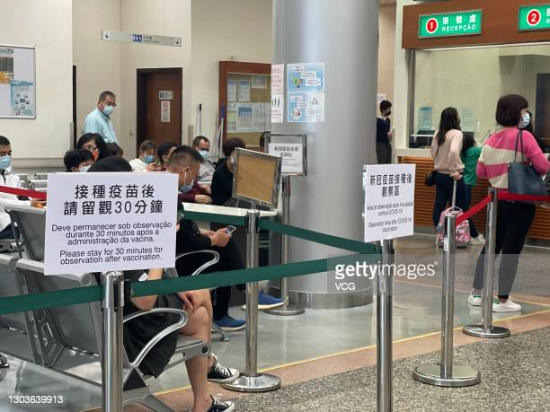 Local residents line up to receive the COVID-19 vaccine at Areia Preta Health Center on February 23, 2021 in Macao, China.