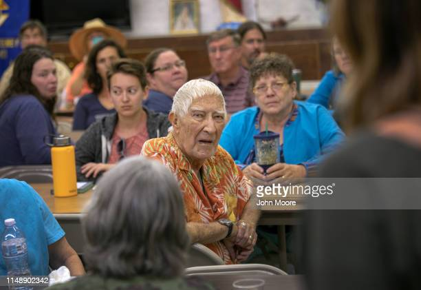 Local residents listen during a community meeting to discuss the federal case against humanitarian aid worker Scott Warren of No More Deaths on May...
