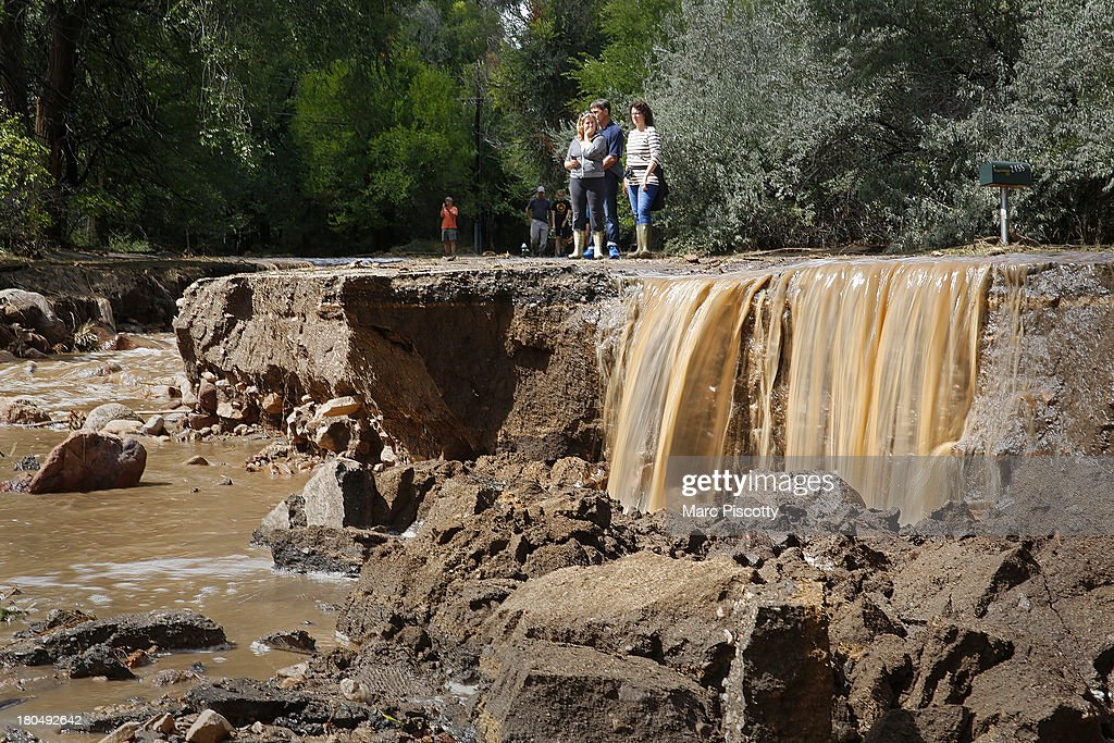 Local residents look at the damage along Topaz Street September 13, 2013 in Boulder, Colorado. Heavy rains for the better part of week has fueled widespread flooding and evacuations in numerous Colorado towns, with the area reportedly already having received 15 inches of rain. Photo by Marc Piscotty/Getty Images)