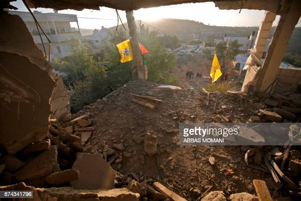 TOPSHOT Local residents look at the remains of the house of Palestinian assailant Nemr alJamal after it was destroyed by Israeli troops in the West...