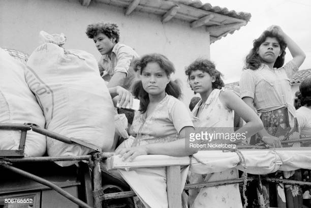 Local residents move their belongings before an assault by the Atlacatl Battalion as soldiers advance in pursuit of guerrillas from the Farabundo...