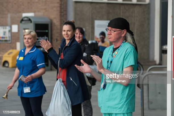 Local residents, NHS staff and police officers applaud key workers at North Middlesex Hospital on May 7, 2020 in London, United Kingdom. Following...