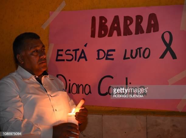 Local residents of the city of Ibarra in northern Ecuador pay homage to the victim at the site where an Ecuadorian woman was murdered by a Venezuelan...