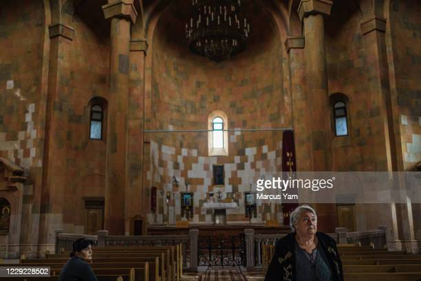 Local residents pray at the Holy Mother of God Cathedral in Stepanakert, Nagorno-Karabakh, which is also internationally recognized as part of...