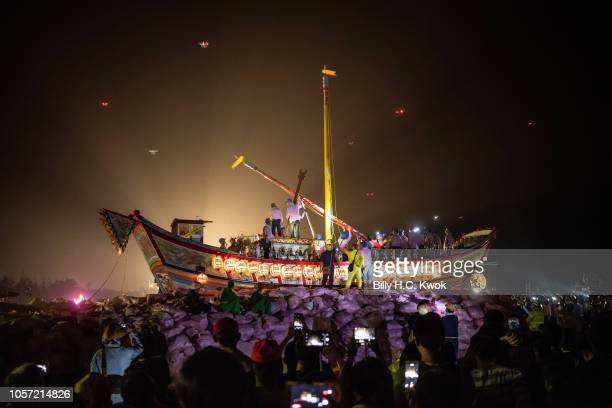 Local residents prepare the 'Wang Yeh's Boat' a 13meter finely crafted ancient warship made of paper and wood for burning during the Pingtung Wang...