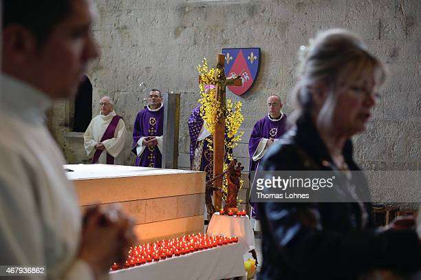 Local residents remember the victims of Germanwings Airbus fight near the crash site at Notre Dame du Bourg cathedral on March 28 2015 in...