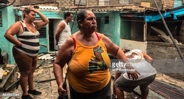 Local residents return home after the passage of Hurricane Irma at Caibarien Villa Clara province 330km east of Havana on September 9 2017 Irma's...