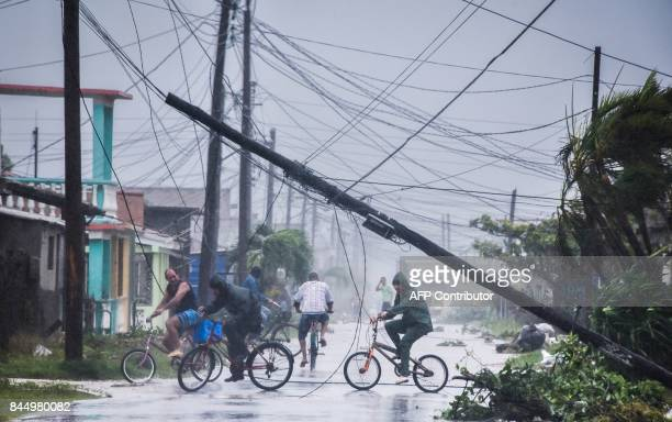 TOPSHOT Local residents return home after the passage of Hurricane Irma in Caibarien Villa Clara province 330km east of Havana on September 9 2017...