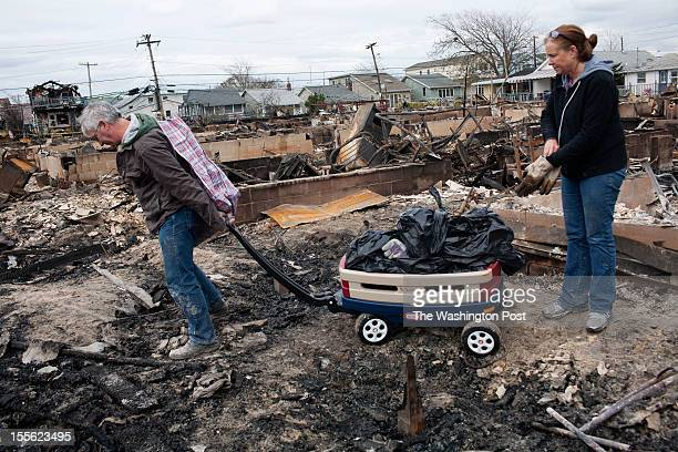 Local residents return to widespread damage and fire that destroyed many houses, caused by Hurricane Sandy in the Breezy Point section of the...