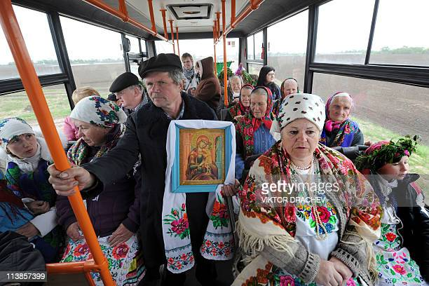 Local residents ride in a bus to take part in a traditional festival to ask for a good harvest outside of the Belarussian village of Pogost some 250...