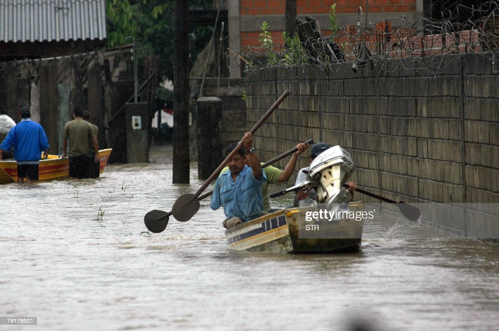 Local residents sail on boat in the flooded streets of Villarroel, some 270km east of Cochabamba, center Bolivia, after the overflowing of the Ichilo and Sajta rivers, 23 January, 2008. The Bolivian government decreed on Tuesday a national emergency to counteract damages caused by heavy rains and floods battering the country since last November. According to last official sources, 27 people died so far, four are still missing and about 21,500 families have been seriously damaged.