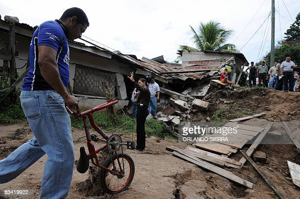 Local residents salvage their belongings from their wrecked houses on October 24 2008 at El Eden neighborhood on the side of El Picacho hill in...