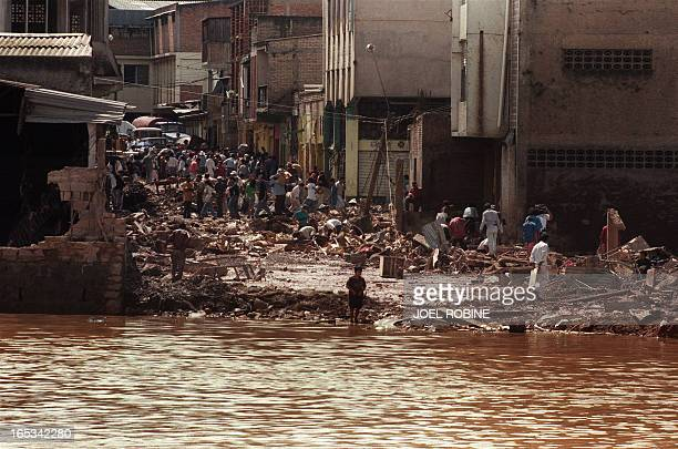 Local residents search through the rubble in Tegucigalpa 13 November 1998 after Hurricane Mitch hit the country Officials report that more than...