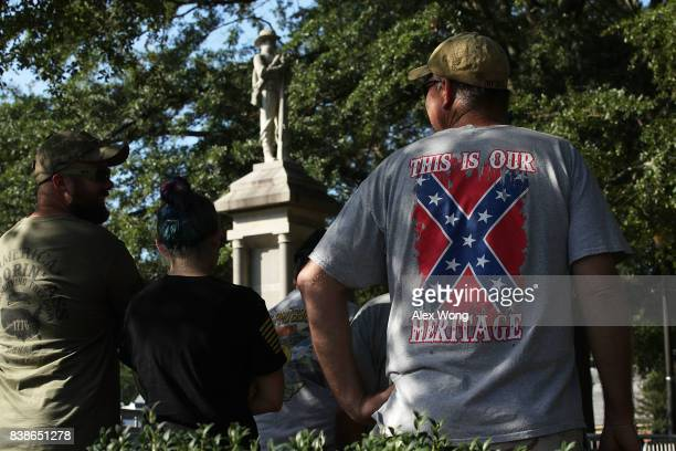 Local residents show support for a Confederate soldier statue during a rally held by activist groups calling for its removal on the grounds of the...