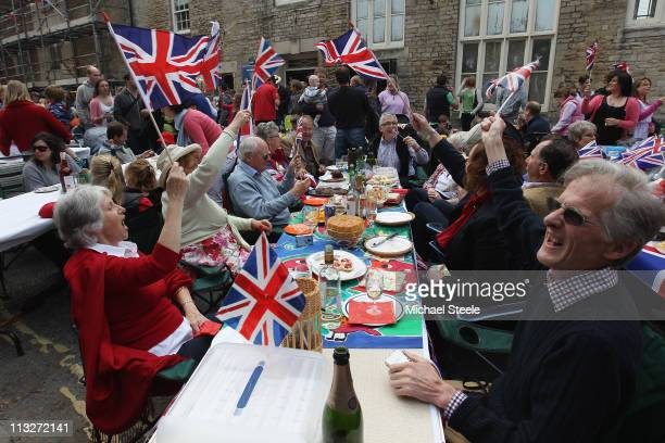 Local residents sing along during street party celebrations on April 29 2011 in Tetbury England The marriage of Prince William the second in line to...