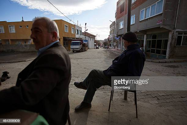 Local residents sit outside a tea house near the projected site for the development of Istanbul's third airport in the village of Yenikoy Turkey on...